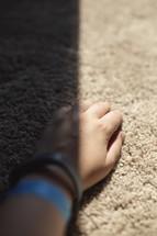 hand on carpet