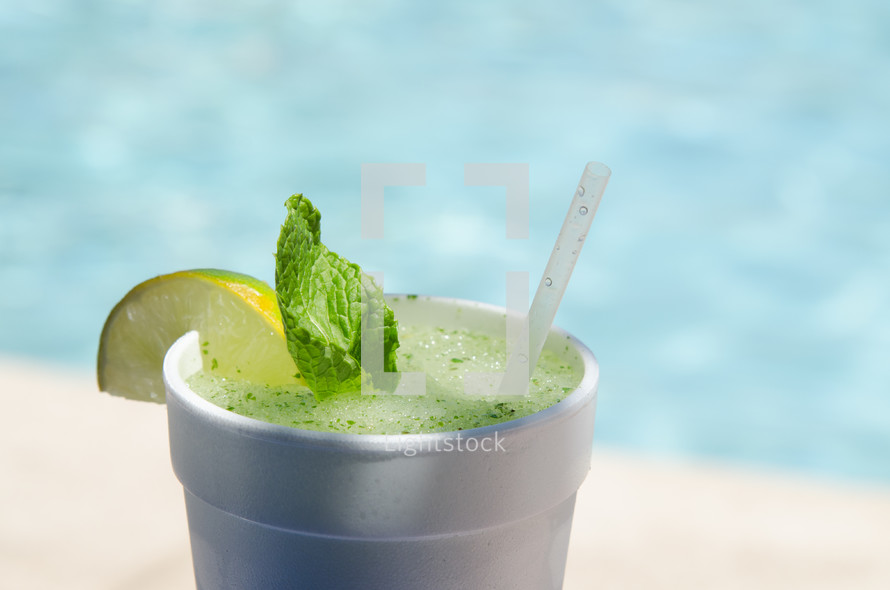 Cup of mint lemonade at the beach.