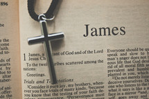 James and a cross necklace