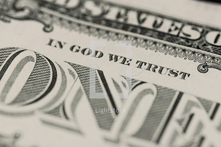 "Closeup of a dollar bill showing ""In God We Trust"""