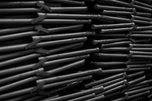 Closeup of a stack of folding chairs.