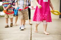 preschoolers walking in a line