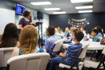 teens listening in a classroom