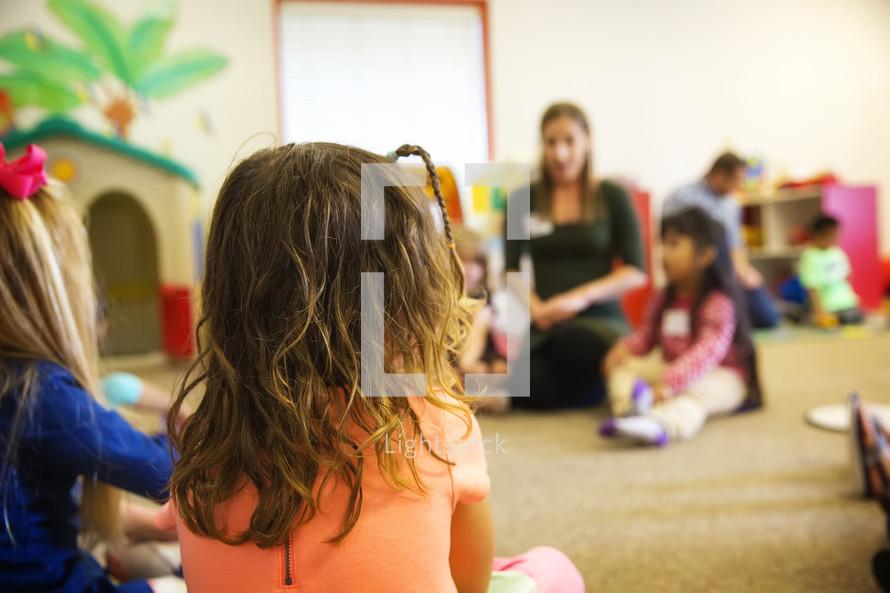 children listening in a classroom