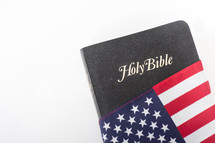 Holy Bible wrapped in an American flag.