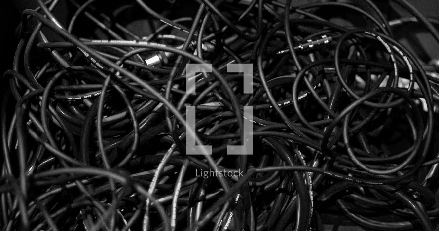A mess of sound cables on stage.