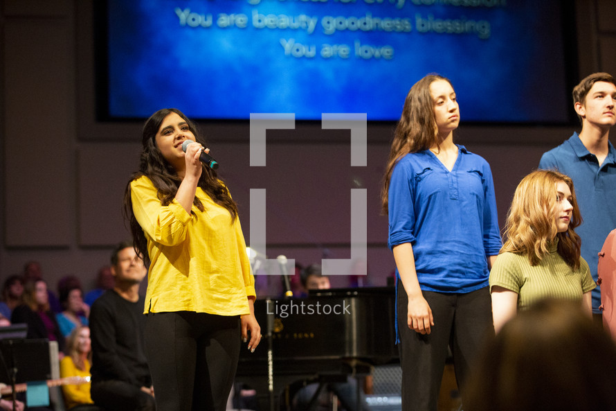 girls singing during a worship service