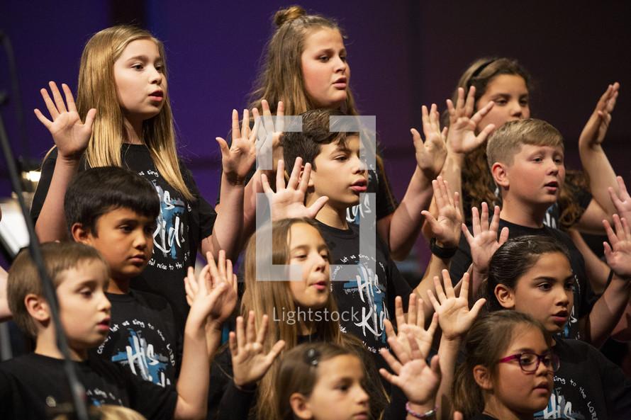 children's choir signing