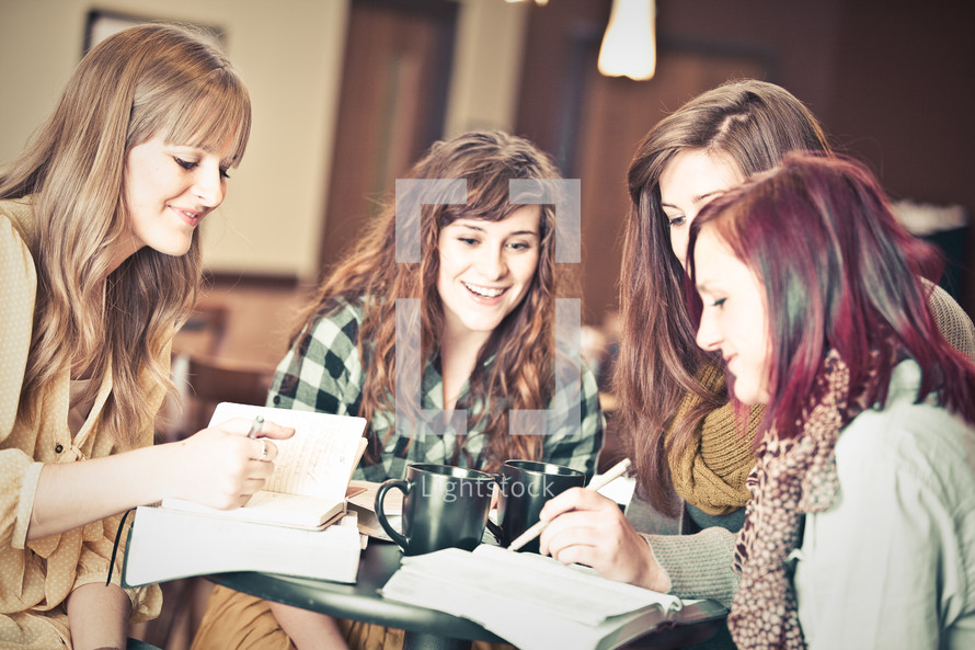 young women discussing scripture at a Bible study