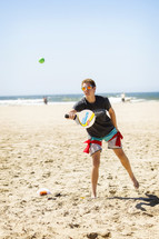 teens playing on a beach