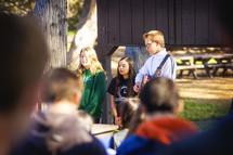teens singing outdoors