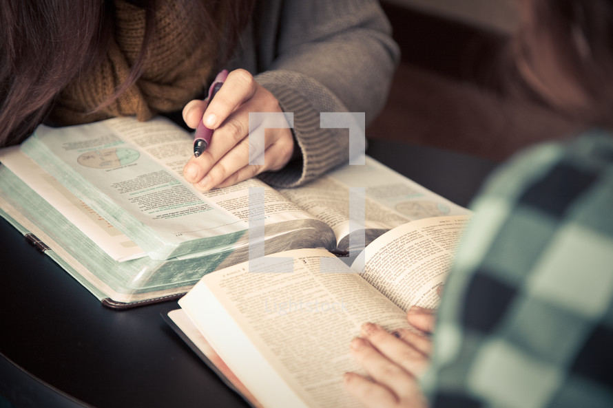 women reading from the Bible at a Bible study