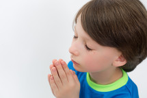 Boy praying.