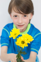 boy child holding a bouquet of picked flowers