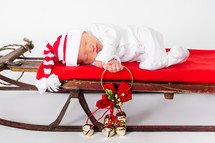 baby on a Christmas sleigh