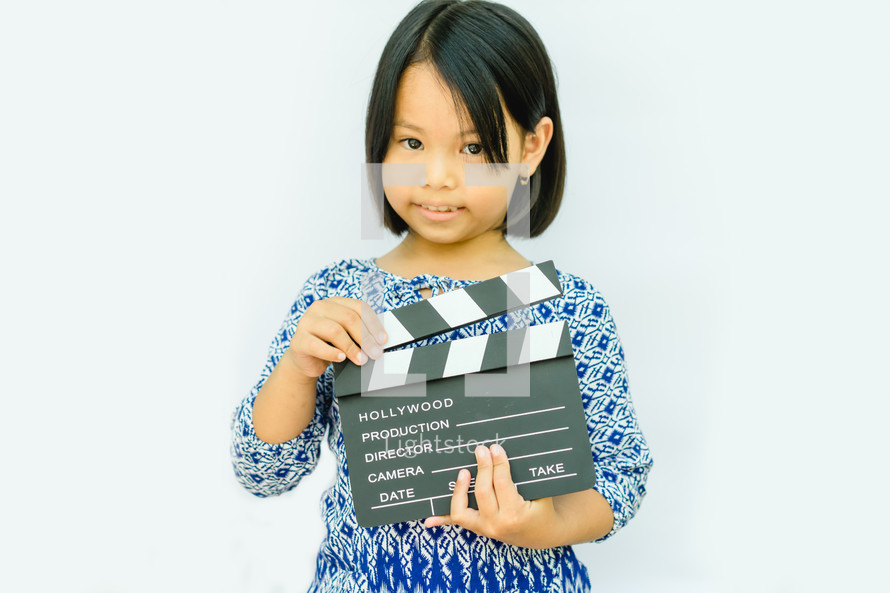 girl holding a clapper board