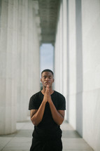 African American man in prayer