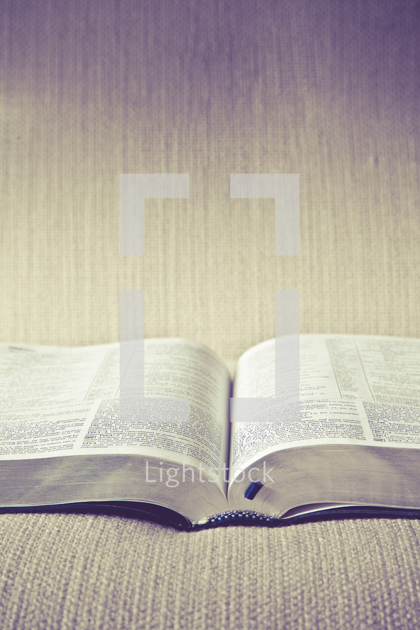 open Bible lying on a couch