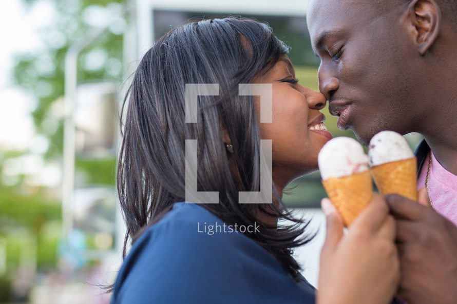 an African American couple eating ice cream