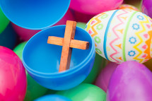 plastic Easter eggs filled with a small wooden cross