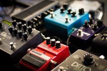 Closeup of an array of guitar foot pedals.