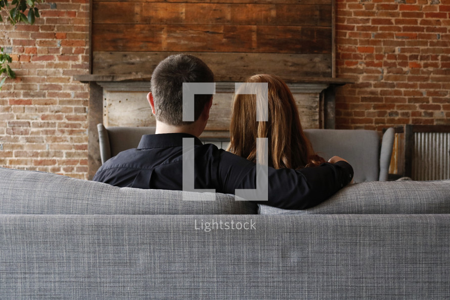 a couple sitting on the couch