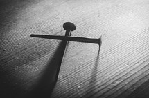 A b&w shot of two old nails forming a cross