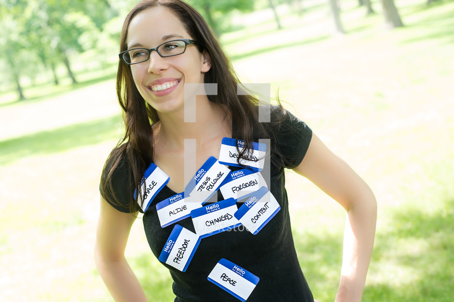 woman wearing name tags