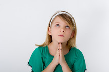 Girl praying while looking to heaven.