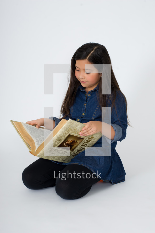 Girl reading the Bible.