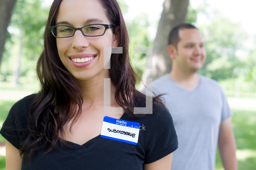 submissive name tag on a woman