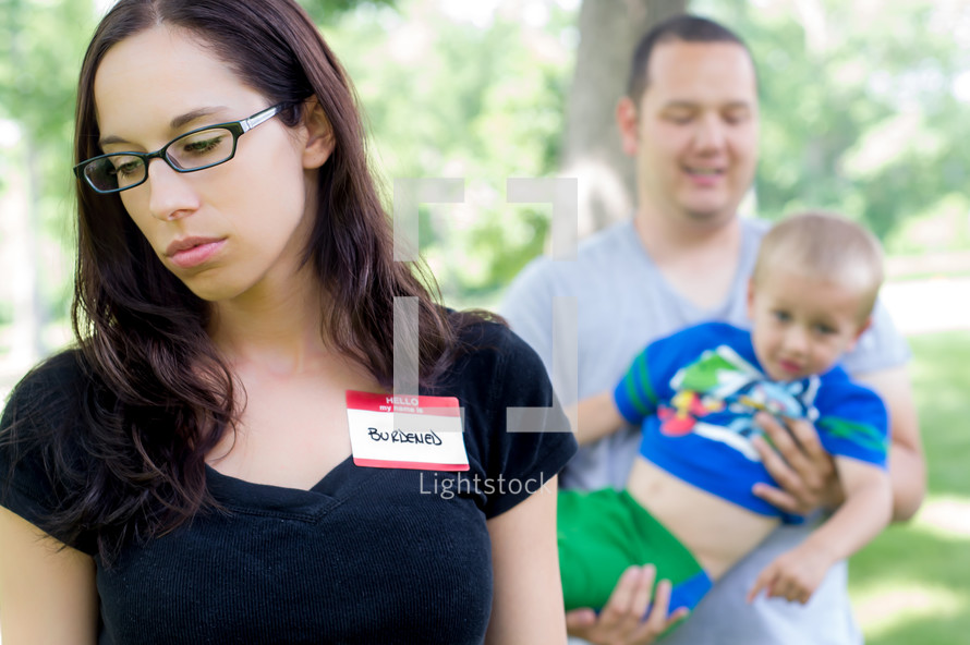 woman wearing burdened name tag