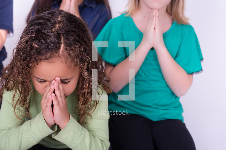 Children praying together.