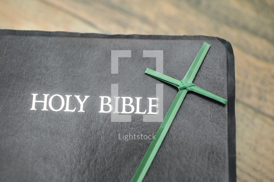 Flax cross on Bible.