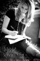 girl writing in a diary