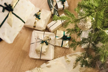 wrapped Christmas presents under a Christmas tree