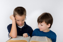 Boys reading the Bible.
