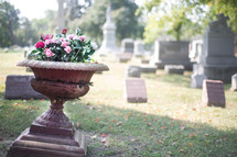 flowers in a planter in a cemetery - life and death