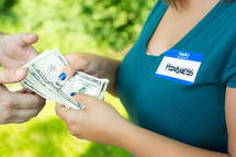 kindness name tag - woman giving money