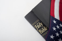 Bible draped with American flag