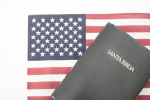 Spanish Bible on an American flag.