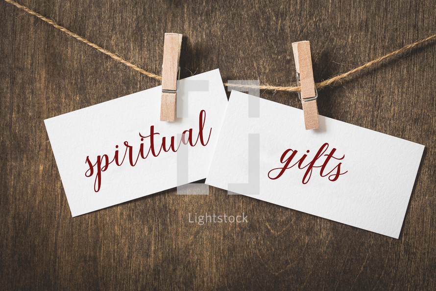 words spiritual gifts on card stock hanging on twine by a clothespin