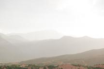 mountainous landscape on a foggy morning