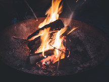 A small bonfire is burning.