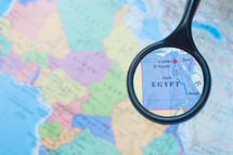 magnifying glass over a map of Egypt