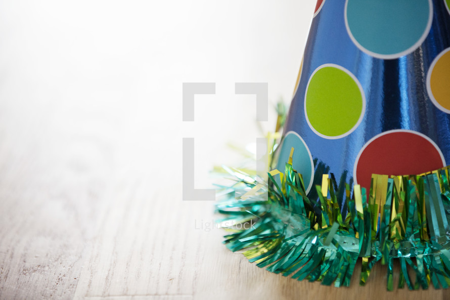 A party hat resting on a table.