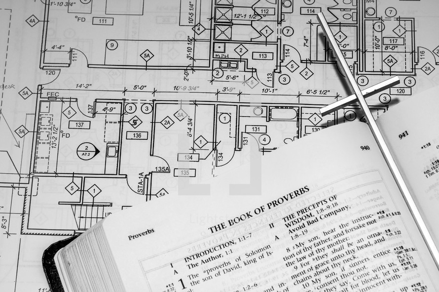 blueprints and an opened Bible