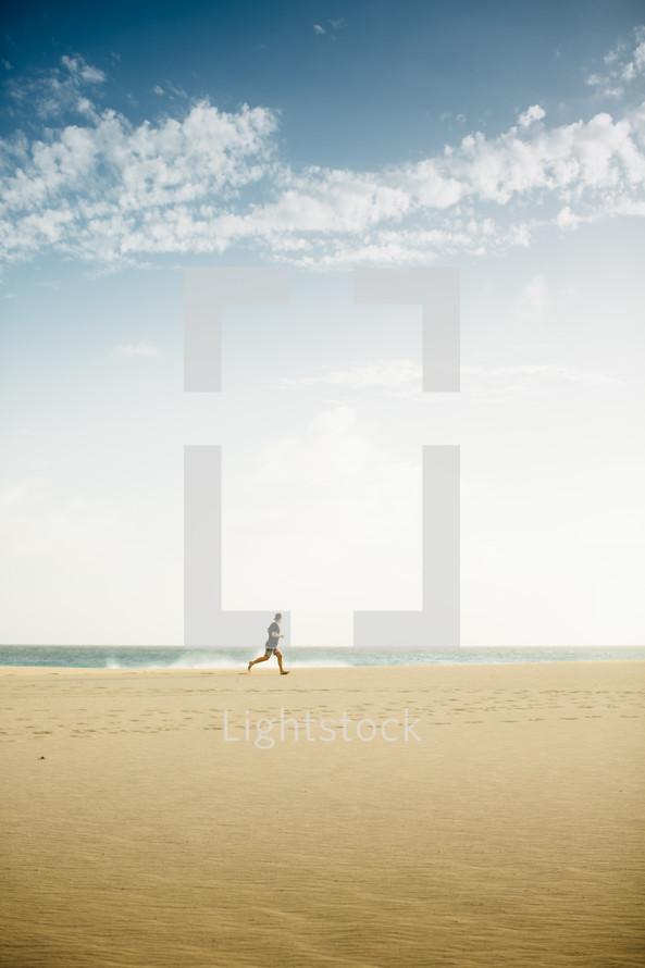 a man running on a beach