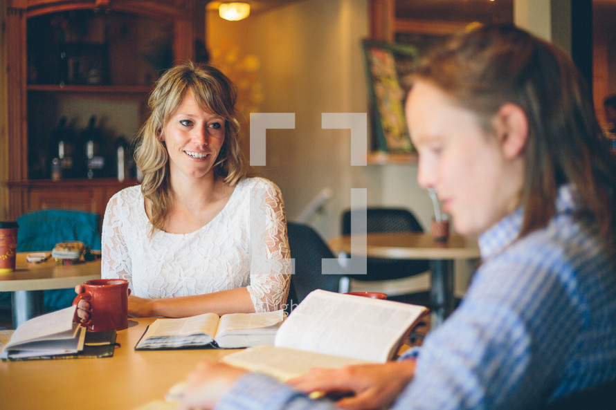 woman reading a Bible at a Bible study