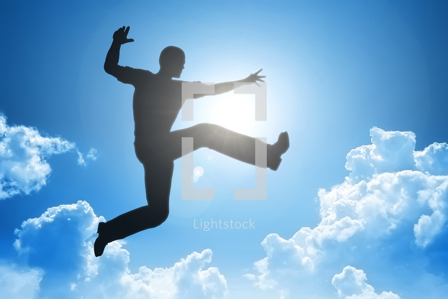 silhouette of a man leaping